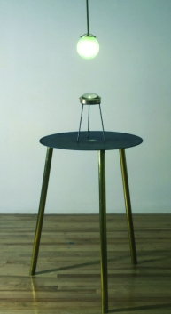 Bill Jones, As Above, So Below, 1988, Brass and steel stands and fittings, lens, lamp.