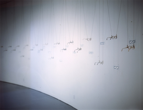Bill Jones, Second Sight, found eyeglasses, ball chain, alligator clips. Installation view The Koffler Gallery, May 8- June 15 1997.