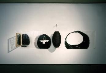 Bill Jones, The Uses of Would, 1988, Silver print, lantern, window, 122 x 549 cm, 48 x 216 in, Installation view YYZ Gallery, Toronto.